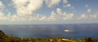 Pitcairn Island. From Big Flower the cruise ship is seen sailing away.